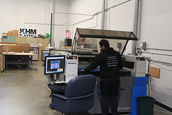 Man opperating a laser cutting machine