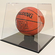 Basketball enclosed in plastic display box