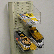 Clear plastic container on pegboard